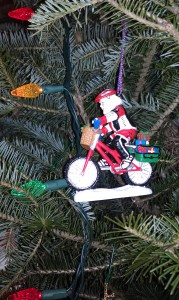 Santa Claus on a bicycle tree ornament